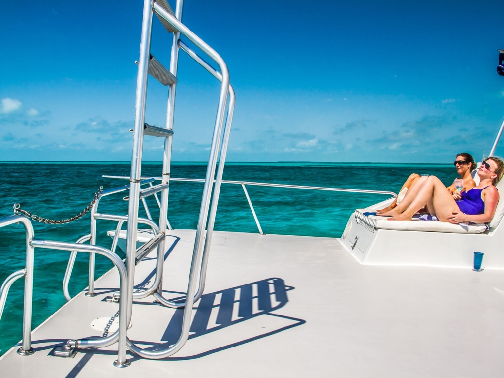 Comfortable cushioned lounge seating, wide open flat deck and our extra wide swim ladder